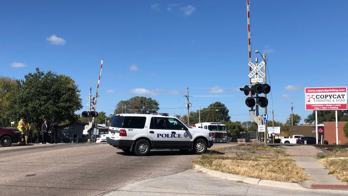 A Grand Island Police vehicle sits in front of the railroad crossing at the intersection of...