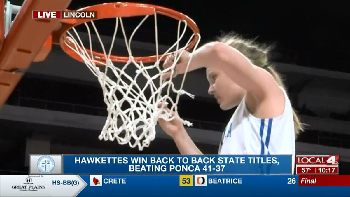 Bailey Kissinger cuts down the nets after St. Cecilia's second straight state title.