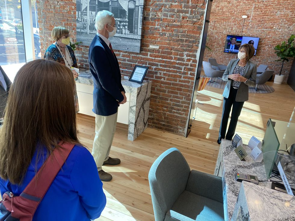 Lt. Governor Mike Foley stands in Pinnacle Bank during his tour of downtown Grand Island.