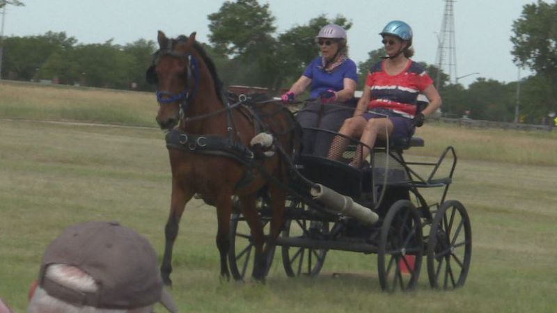 Whips in Nebraska drivers make their way through an obstacle course at the Stuhr Museum.
