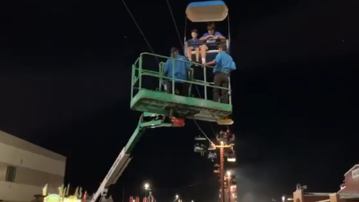 Crews work to get people off of the Nebraska State Fair Sky Tram after it stopped working...