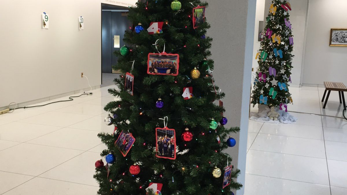 """You can see the """"Local4Local4You"""" tree at the Stuhr Museum's annual """"Fantasy of Trees"""" exhibit this year. It's decorated with photos of the Local4 team, and presents to each of the Tri-Cities. (KSNB)"""