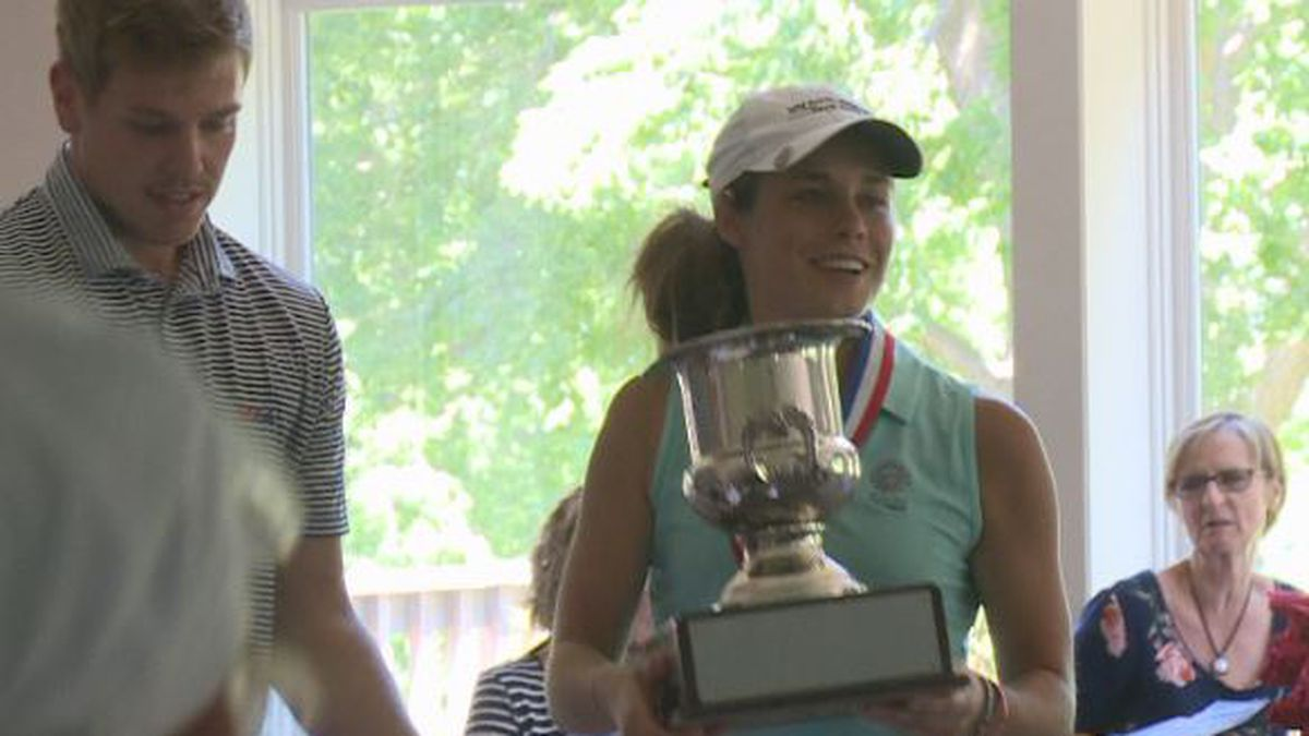 Haley Thiele holds up the trophy, after winning the 45th annual Nebraska Women's Amateur Championships