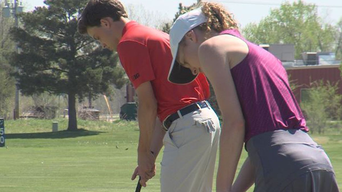 Caleb and Danica Badura practice some putts at teh Riverside Country Club in Grand Island.