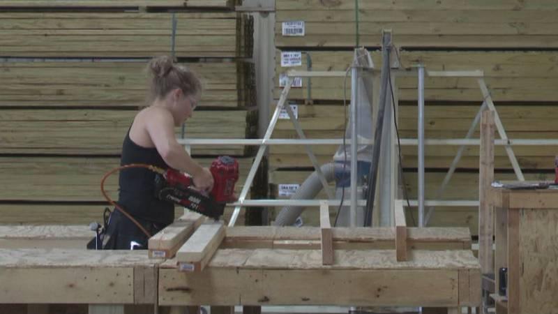 A Truss Craft employee builds trusses for Habitat Blitz home.